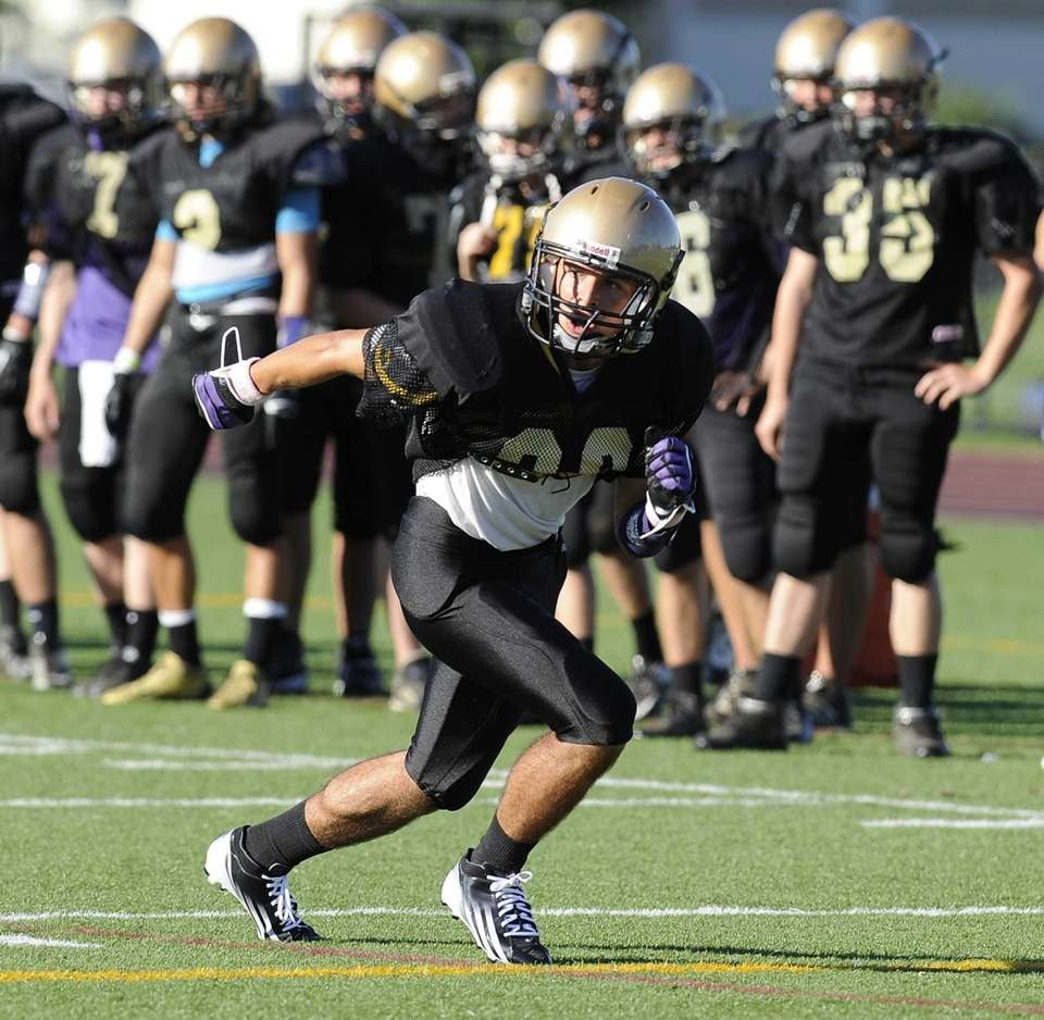 Sayville's Jimmy Giattino runs a play against Bay