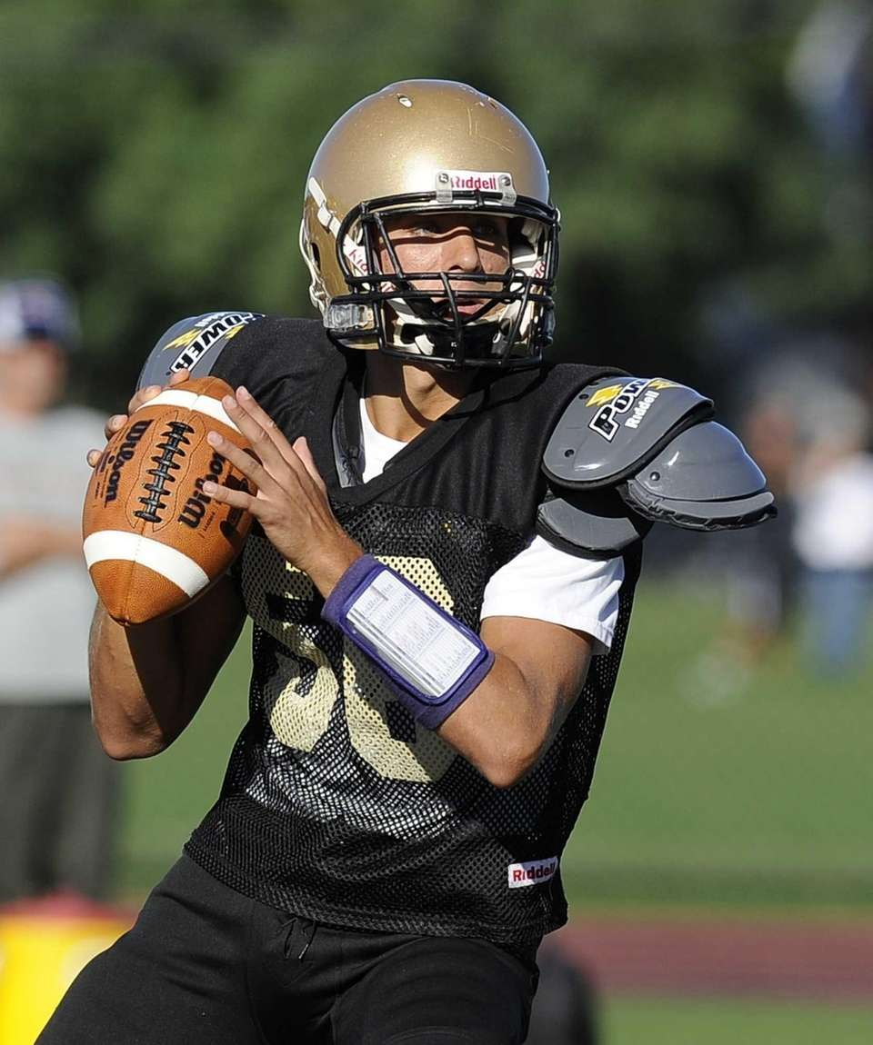 Sayville quarterback Zack Sirico looks to pass against