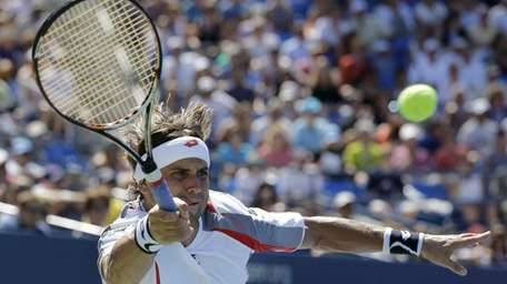 David Ferrer of Spain reaches for the ball