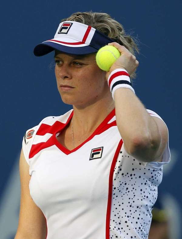 Kim Clijsters of Belgium pauses during her match