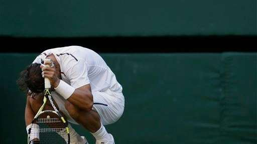 Rafael Nadal hunches over after he lost the