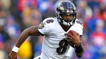 Ravens quarterback Lamar Jackson carries the ball during