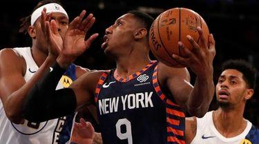 RJ Barrett of the Knicks tries to get