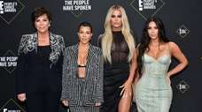 Kourtney, left, Khloé and Kim Kardashian attend the