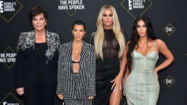 Kourtney, left, Khloé and Kim Kardashian attend the