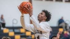 Sachem North's Anthony Holloway shoots during a Suffolk