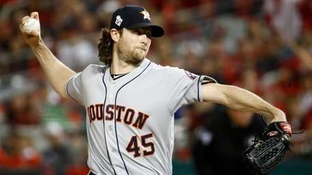 Astros starting pitcher Gerrit Cole throws against the