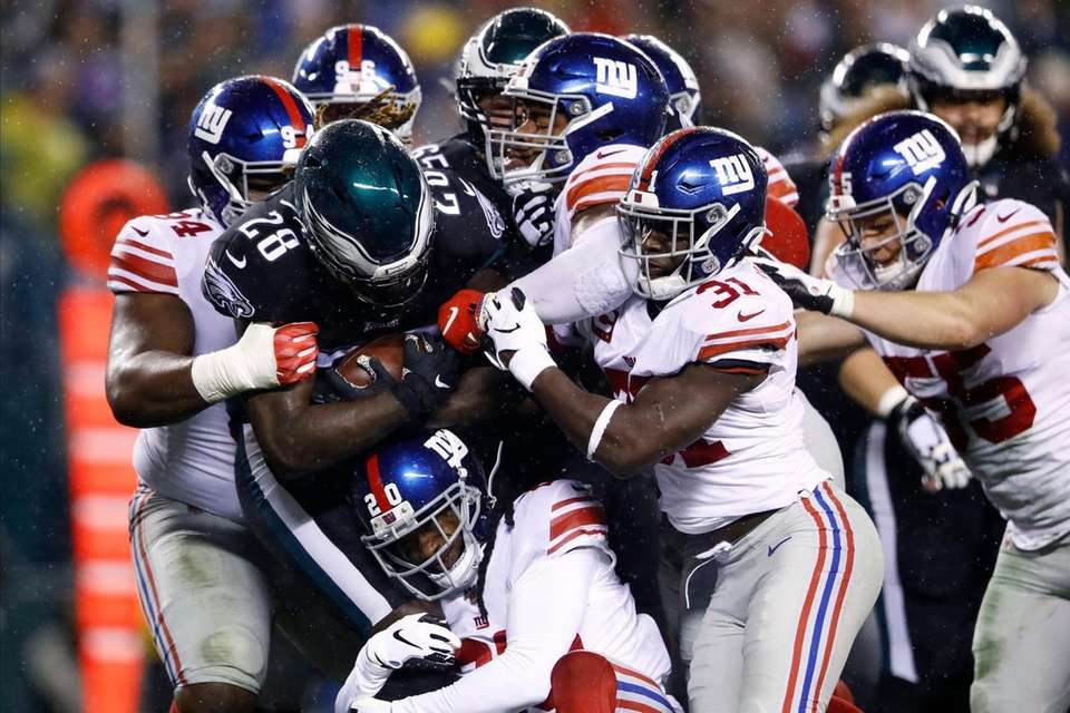 Philadelphia Eagles' Jay Ajayi is tackled by the