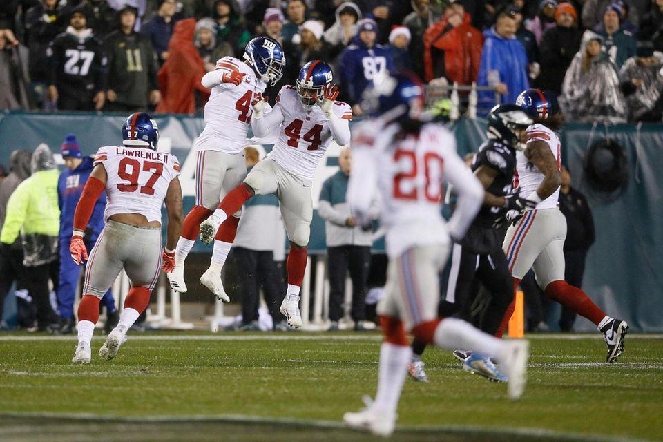 The Giants' Markus Golden and Alec Ogletree celebrate