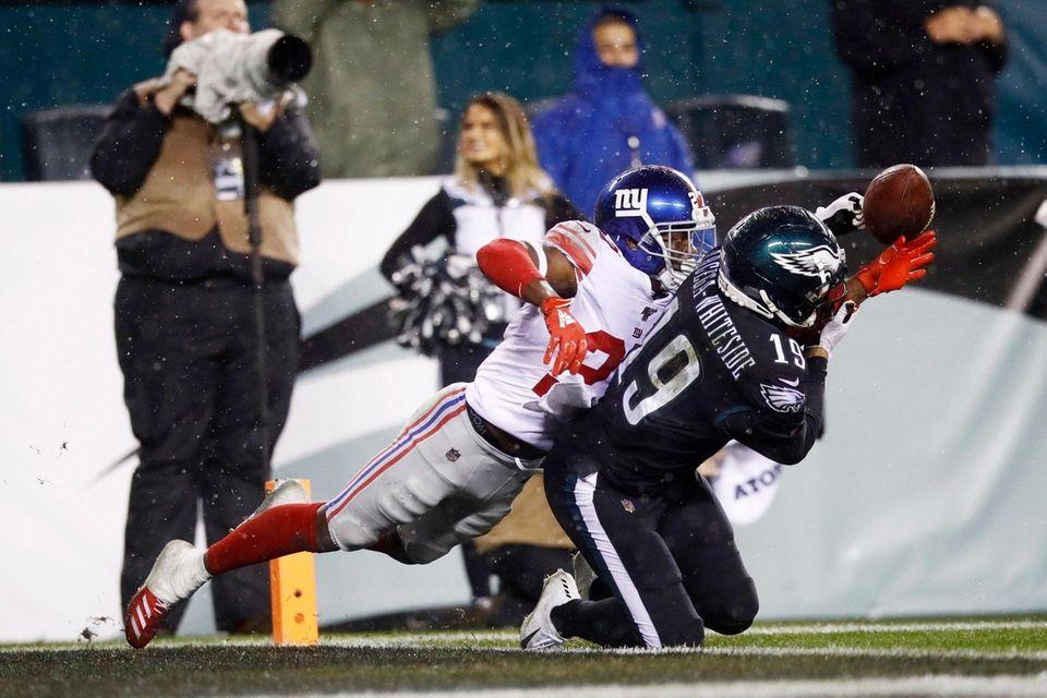 The Giants' Deandre Baker, left, breaks up a