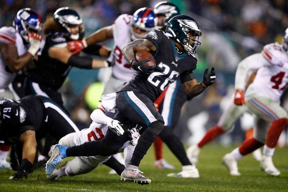 Philadelphia Eagles' Miles Sanders rushes during the second