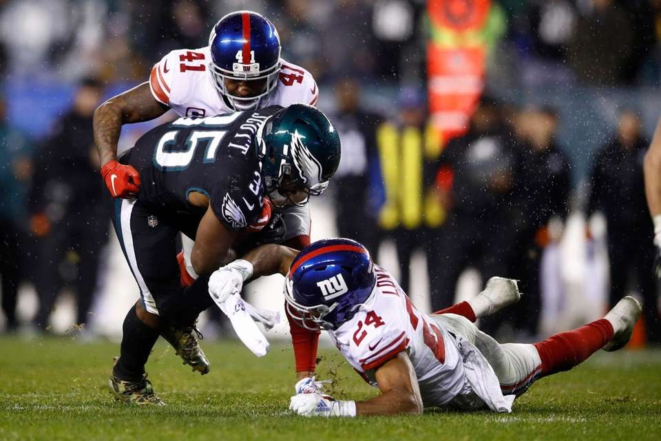 Philadelphia Eagles' Boston Scott is tackled by the