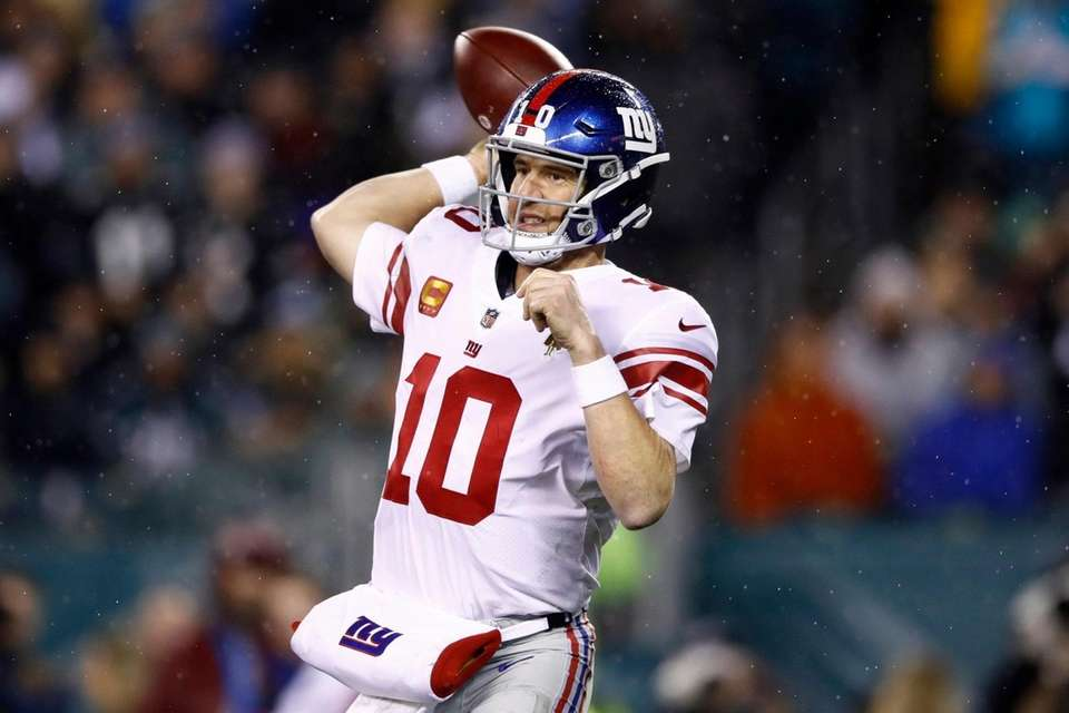 The Giants' Eli Manning passes during the second