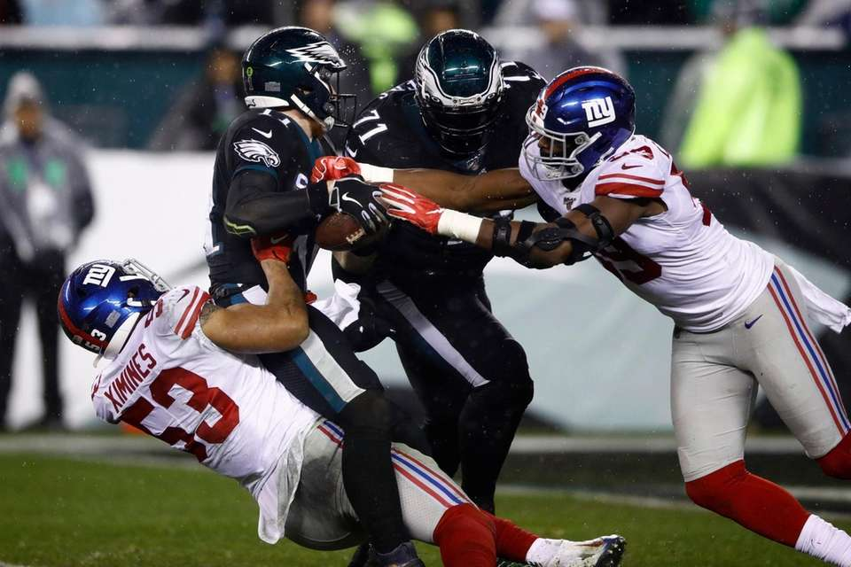 Philadelphia Eagles' Carson Wentz is tackled by the