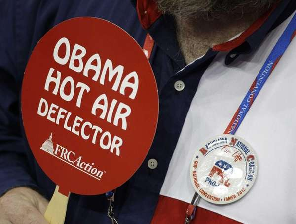 A delegate from Texas holds up an anti-Obama