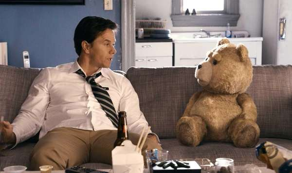 "Mark Wahlberg with the title character of ""Ted,"""