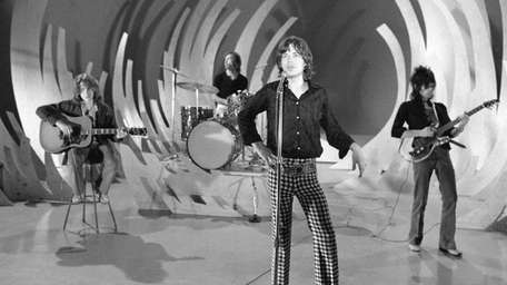 The Rolling Stones rehearse for an appearance on