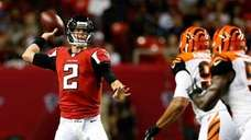 Matt Ryan (left) #2 of the Atlanta Falcons