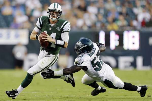 Greg McElroy, left, scrambles away from Philadelphia Eagles