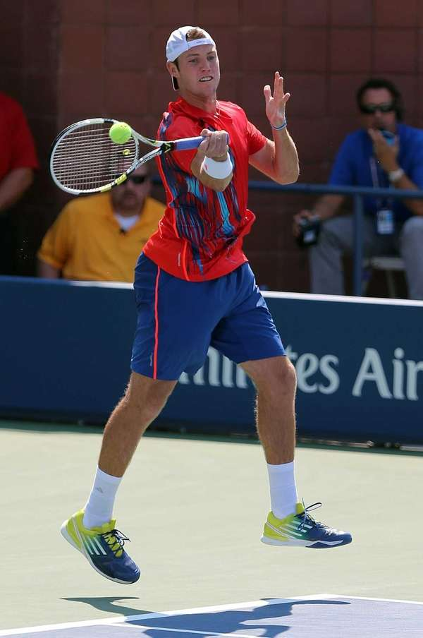 Jack Sock returns the ball with a forehand