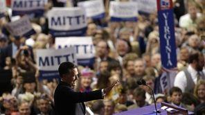Republican presidential nominee Mitt Romney acknowledges delegates before