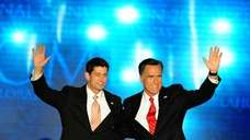 Republican Presidential candidate Mitt Romney, right and his