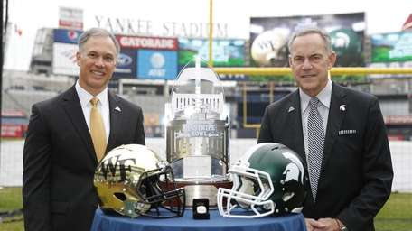 Wake Forest head coach Dave Clawson, left, and