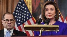House Speaker Nancy Pelosi, flanked by House Judiciary