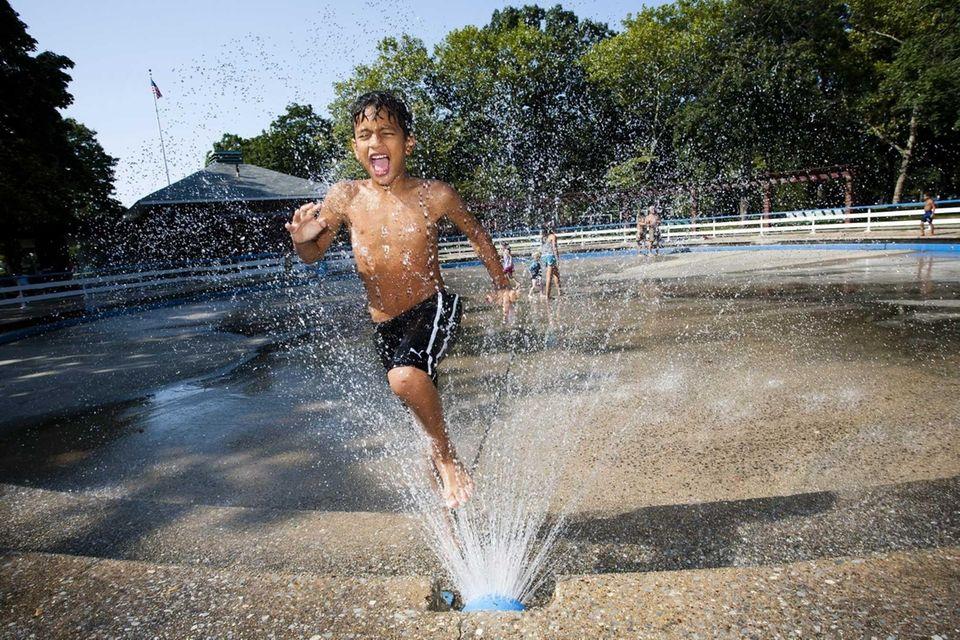 Jamal Ibrahim, age 8, beats the heat by