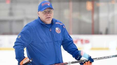 Barry Trotz, Islanders head coach, runs practice at