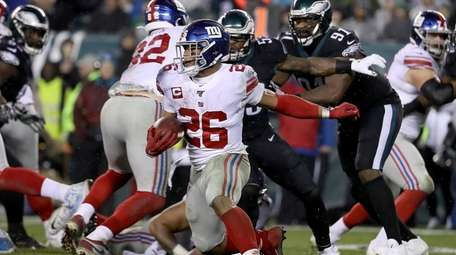 Giants' Saquon Barkley looks for running room against