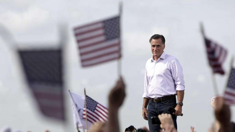 Republican presidential candidate Mitt Romney appears on stage