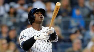 Didi Gregorius #18 of the Yankees follows through