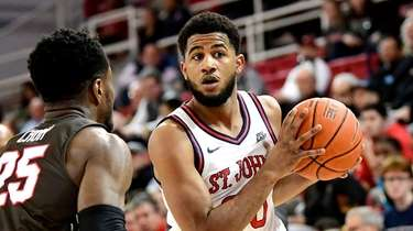 LJ Figueroa #30 of the St. John's Red