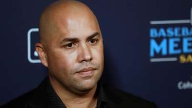 Mets manager Carlos Beltran listens to a question