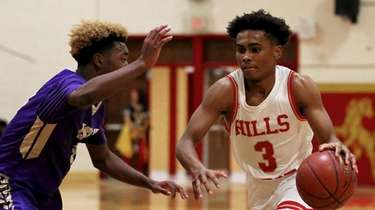 Hills West guard Bryce Bland drives the lane