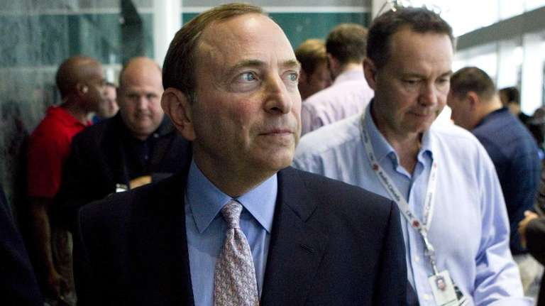 NHL commissioner Gary Bettman leaves after speaking to