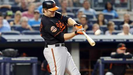 Mark Reynolds of the Baltimore Orioles connects on