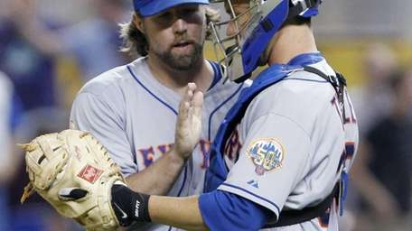 R.A. Dickey, left, and catcher Josh Thole celebrate