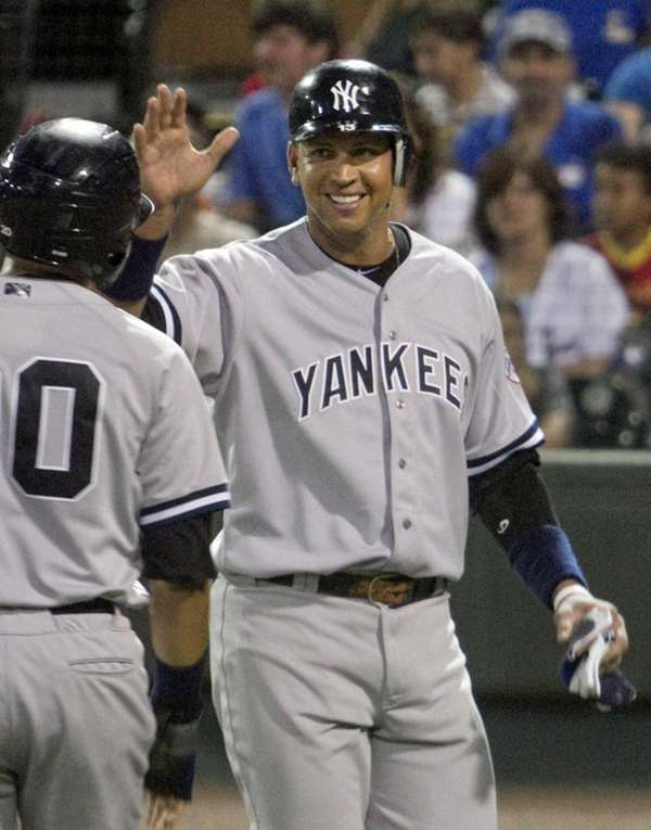 Alex Rodriguez, right, is congratulated by teammate Ramon