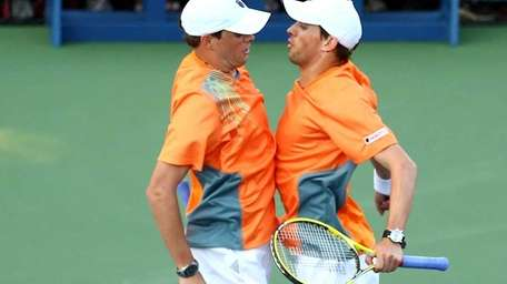 Bob Bryan and Mike Bryan chest bump as