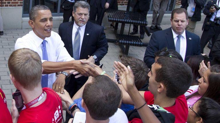 President Barack Obama greets people at the Ohio