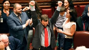 Sen. Luis R. Sepulveda, D-Bronx, center, celebrates after