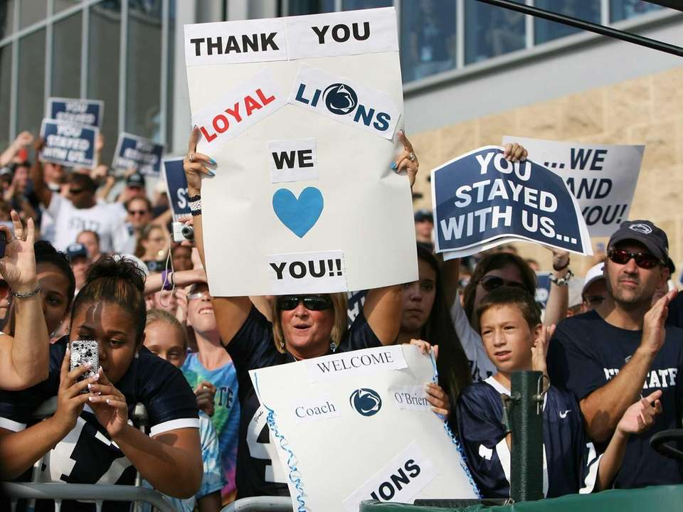 Fans cheer on the Penn State football team