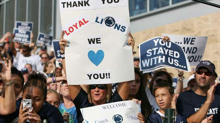 Fans cheer on the Penn State football team