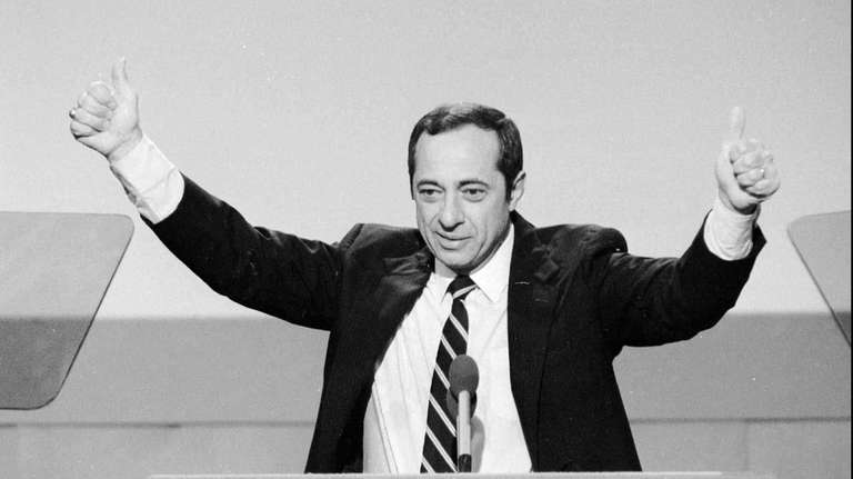 New York Gov. Mario Cuomo gives the thumbs