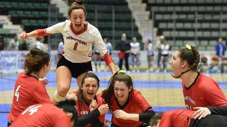 Julia Patsos and Connetquot teammates celebrate their state