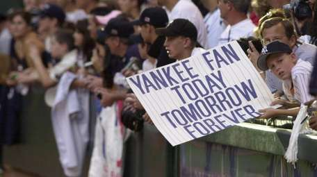 Future Yankee pitcher Gerrit Cole, holding a sign,