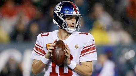 The Giants' Eli Manning plays during the first
