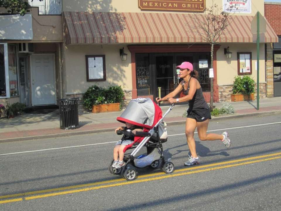 A runner pushes her stroller during the Main